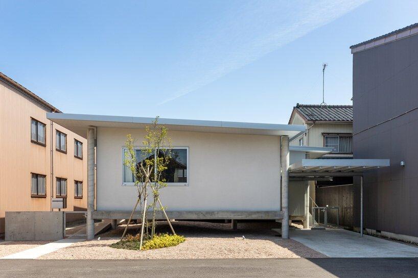 UNEMORI ARCHITECTS elevates flood-proof house on stilts in takaoka, japan