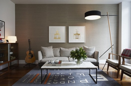 Grasscloth backdrop lets the framed artwork standout beautifully