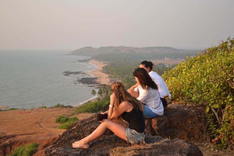 Foreigners seating beside a fort in Goa