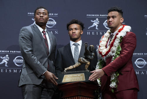 Heisman Trophy finalists, from left, Dwayne Haskins, from Ohio State; Kyler Murray, from Oklahoma; and Tua Tagovailoa, from Alabama, pose with the trophy