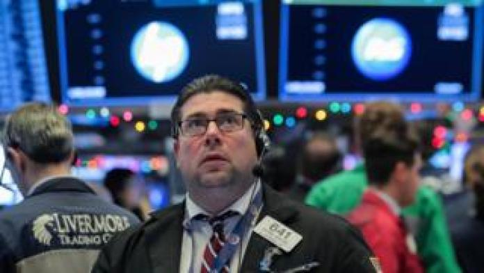 Traders work on the floor of the New York Stock Exchange (NYSE) in New York, U.S., December 7, 2018.