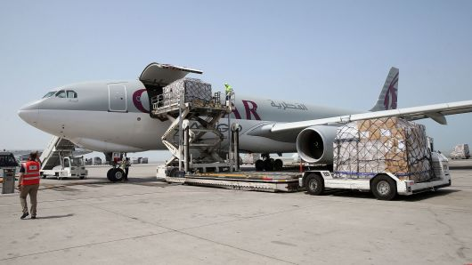 Workers offload cargo from a Qatar Airways Cargo plane at the Hamad International Airport in Doha on July 20, 2017.
