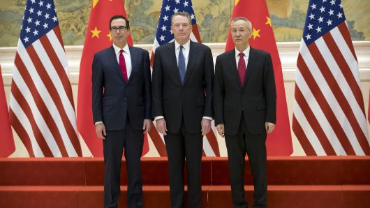 (L-R) US Treasury Secretary Steven Mnuchin, US Trade Representative Robert Lighthizer and Chinese Vice Premier Liu He pose for a group photo at the Diaoyutai State Guesthouse in Beijing on February 15, 2019.