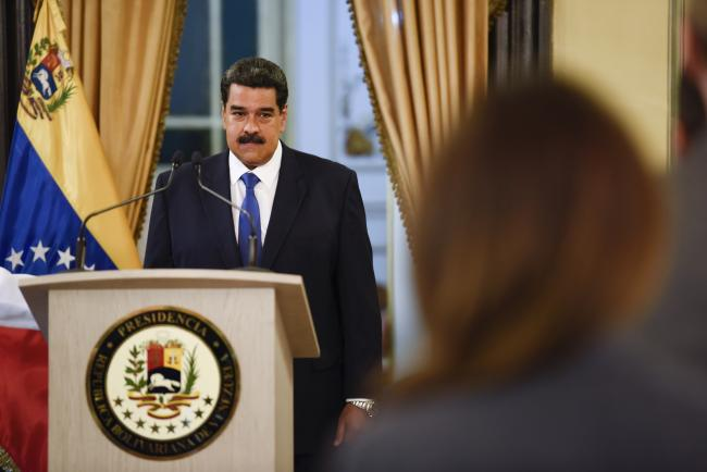 © Bloomberg. Nicolas Maduro, Venezuela's president, arrives to speak during a televised press conference in Caracas, Venezuela, on Friday, Feb. 8, 2019. Maduro denounced the presence of trailers of humanitarian aid brought to the Colombian border, calling them part of a plan cooked up in Washington to destabilize his government.