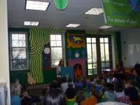 "A ""Goodnight Moon"" mural is the backdrop as Kathleen Buretta, of the Shirley Public Library's Children's Services Division,"