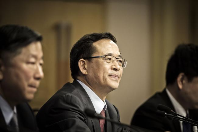 "© Bloomberg. Liu Shiyu, chairman of the China Securities Regulatory Commission (CSRC), looks on during a news conference on the sidelines of the fourth session of the 12th National People's Congress (NPC) in Beijing, China, on Saturday, March 12, 2016. China's new stock regulator vowed to step in ""decisively"" if needed to stem the sort of stock-market panic that resulted in a $5 trillion wipeout last summer, adding that it was far too early to think about the state rescue fund leaving the market. Photographer: Qilai Shen/Bloomberg *** Local Caption *** Liu Shiyu"