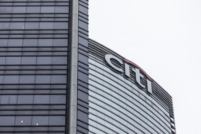 © Bloomberg. The Citigroup Inc. logo is displayed atop the Champion Tower, right, in Hong Kong, China, on Saturday, March 23, 2019. Citigroup, the global investment bank with a major presence in Asia, has ousted eight equities traders in Hong Kong and suspended three others after a sweeping internal investigation into its dealings with some clients, people familiar with the matter said. Photographer: Justin Chin/Bloomberg