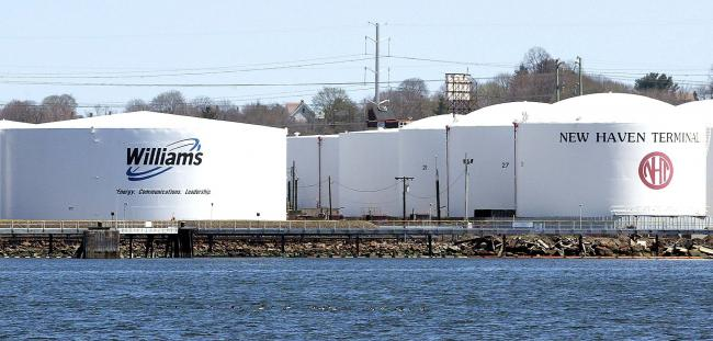 © Bloomberg. Natural-gas storage tanks at the Williams Energy Partners terminal at New Haven, Connecticut, are pictured on Monday, April 21, 2003.