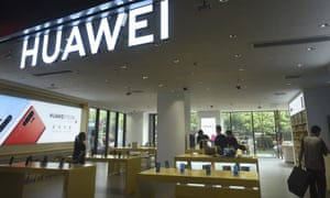 Shoppers browse smartphones at a Huawei retail store in Hangzhou in eastern China's Zhejiang province today