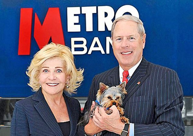 Metro Bank, founded by American billionaire Vernon Hill (pictured here with wife Shirley), was last night locked in talks with investors as it scrambles to raise £350m