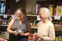 Dorcas Hurd, right, and another volunteer at the Westminster Community Food Pantry, prepare food boxes this week.