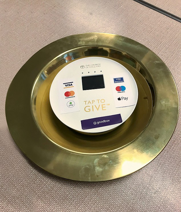 Heaven sent: The collection plate that takes both cash and cards