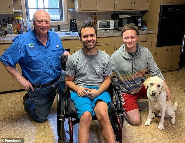 Two months ago, Lafleur acquired a two-year-old service dog named Zeego. Pictured: Lafleur (center) with his dog Zeego and two of Zeego¿s puppy raisers