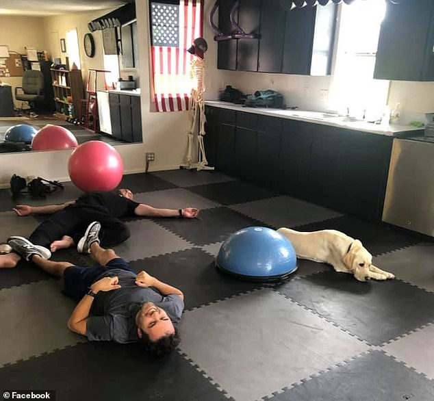 Zeego, a Labrador-Golden Retriever mix, picks things up, opens doors and turns light switches on and off. Pictured: Lafleur (in gray) with his dog at a physiotherapy session