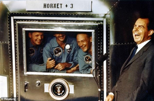 Richard Nixon (right) was prepared in the event that astronauts in the first humans lunar surface walk were stranded and left for dead. In the 1969 photo, astronauts Neil Armstrong (L), Michael Collins (C), and Buzz Aldrin laugh with the president aboard the USS Hornet