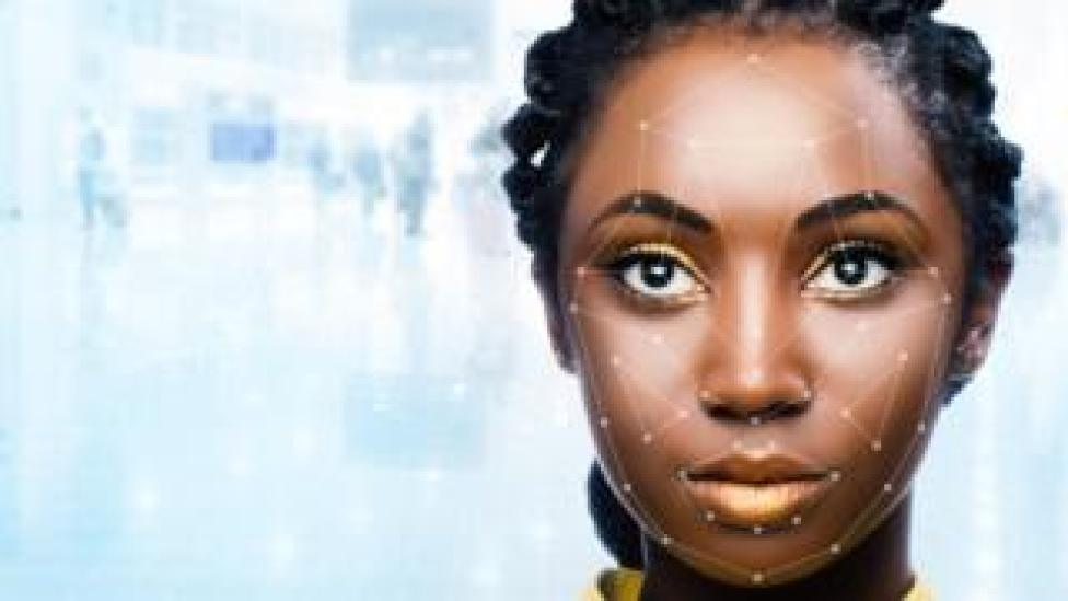 Black woman's face being scanned