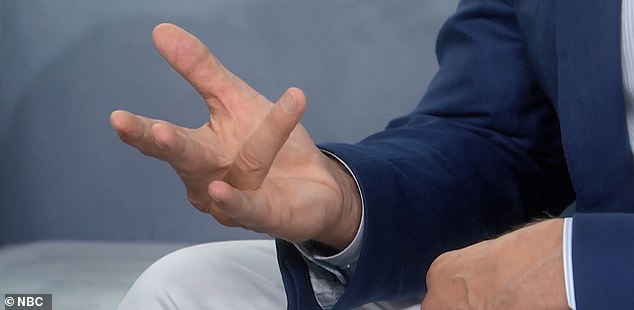 Elway's fingers are currently straight, but they could constrict (pictured) again at any moment