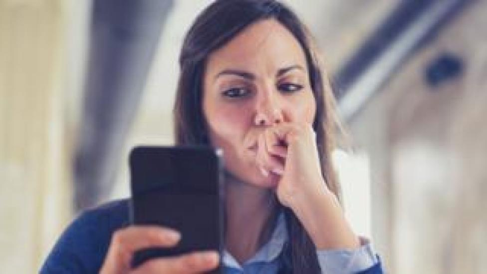 A woman on her smartphone