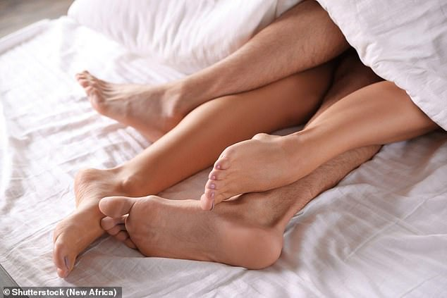 Researchers suggest women who fake orgasms in a bid to turn themselves on may improve their sex lives by making themselves more likely to have real ones (stock image)
