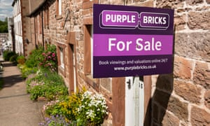 Purplebricks board outside a stone terraced house in Cumbria