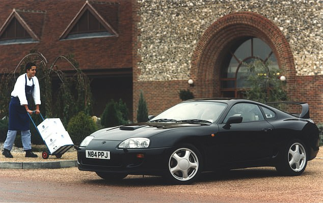 This is a mid-1990s Toyota press shot for the Supra - and no, we have absolutely no idea what they were thinking when they issued an action photo with a hand truck delivery either