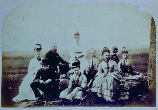 Undated handout photo issued by English Heritage of one of the earliest known family photograph taken at Stonehenge. The Routh family, who are pictured sitting on one of the surrounding stones at the site, enjoyed a day out at the landmark in 1875. PA Photo. Issue date: Thursday December 12, 2019. 148 photos were selected for the exhibition Your Stonehenge- 150 years of personal photos, which is open from Thursday until August 2020. See PA story ARTS Stonehenge. Photo credit should read: The Routh family/English Heritage/PA Wire NOTE TO EDITORS: This handout photo may only be used in for editorial reporting purposes for the contemporaneous illustration of events, things or the people in the image or facts mentioned in the caption. Reuse of the picture may require further permission from the copyright holder.