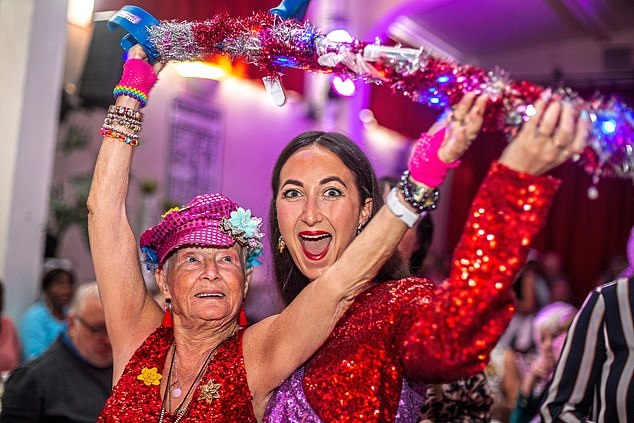 Eve Simmons joins Joan Huxtable, 85 – known as Pinky – on the dancefloor at The Posh Club
