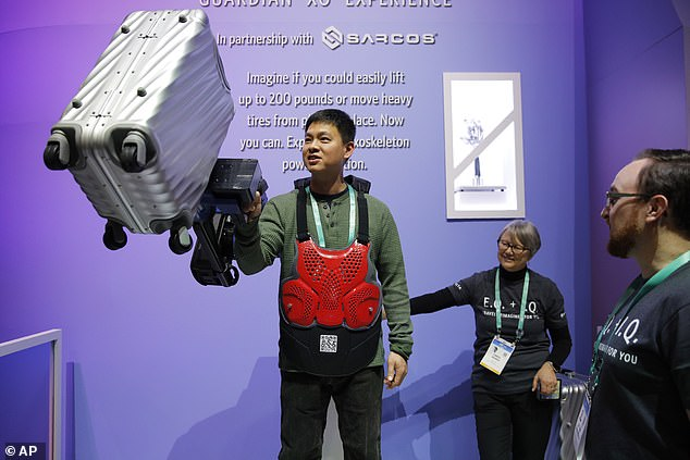 Some lucky attendees got a chance to test the technology, hoisting heavy pieces of luggage into the air using just one arm