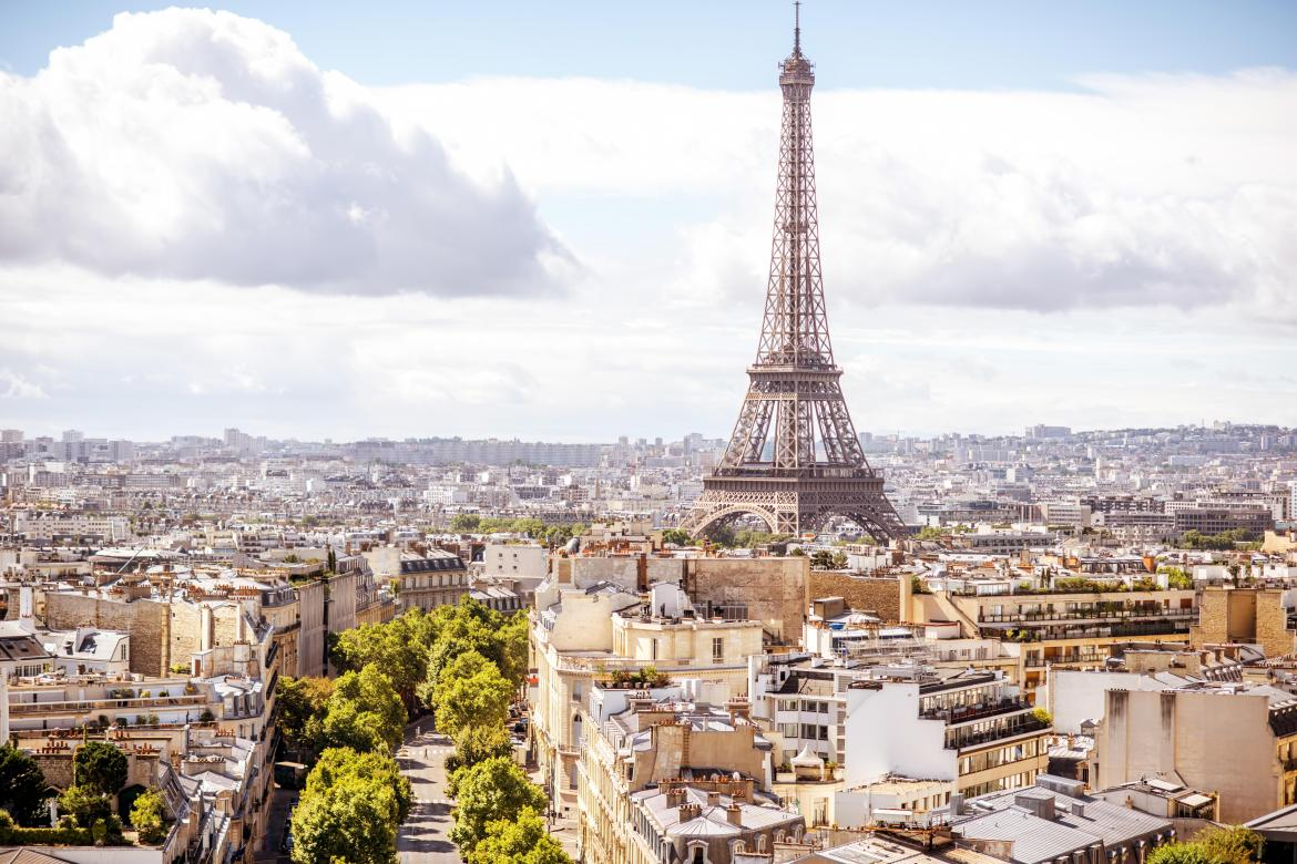 Cityscape view of Paris with the iconic Eifel Tower in the distance