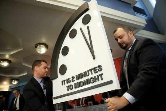 """WASHINGTON, DC - JANUARY 25: The Bulletin of the Atomic Scientists unveil the 2018 """"Doomsday Clock"""" January 25, 2018 in Washington, DC. Citing growing nuclear risks and unchecked climate dangers, the group moved the clock to two minutes before midnight, 30 seconds closer and the closest it has been since the height of the Cold War in 1953. (Photo by Win McNamee/Getty Images)"""