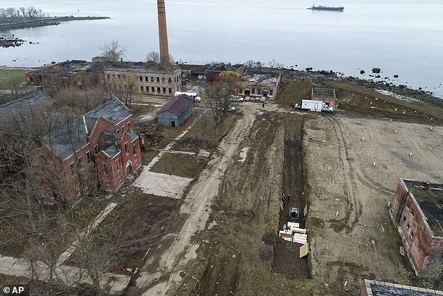 Coronavirus has killed nearly 5,000 people in New York City. Some of their bodies are being buried in plain plywood boxes on Hart Island, horrifying drone photos reveal