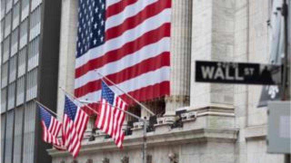Flags fly at full staff outside the NYSE on 9 April 2020 in New York City