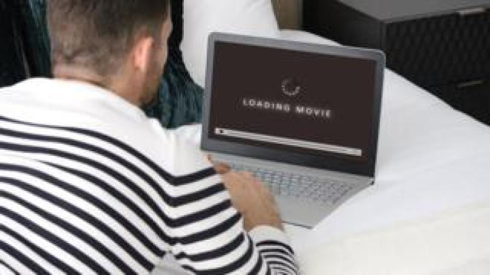 Man downloading a movie