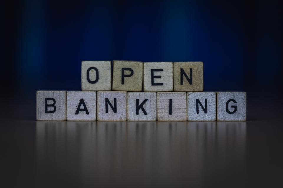 macro shot of wooden cubes on a table showing words OPEN BANKING