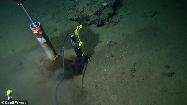 Photograph taken from ALVIN, a manned deep-ocean research submersible, taking sediment cores at the ocean floor of the Dorado Outcrop in 2014
