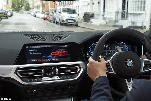 When the car crosses the low-emission boundary, the vehicle's electronic 'brain' knows to switch to pure electric power