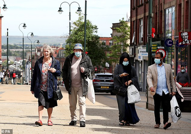 New cases appear to be widespread in the community and not centred in any specific communities. Pictured: Shoppers in Oldham on July 30