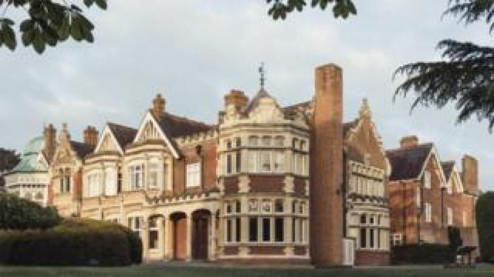 An external view of Bletchley Park, an elaborate British country house made of red brick with fine external decorative work