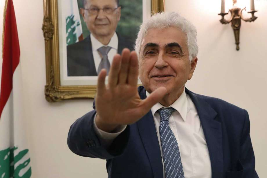 """Lebanese Foreign Minister Nassif Hitti, gestures as he prepares to leave his office after he announced his resignation at the foreign ministry, in Beirut, Lebanon, Monday, Aug. 3, 2020. Hitti resigned on Monday amid the severe economic crisis gripping the crisis-wracked Arab country, warning a lack of vision and a will to make changes risked turning the country into a """"failed state."""" Photo: Hussein Malla, AP / Copyright 2020 The Associated Press. All rights reserved."""