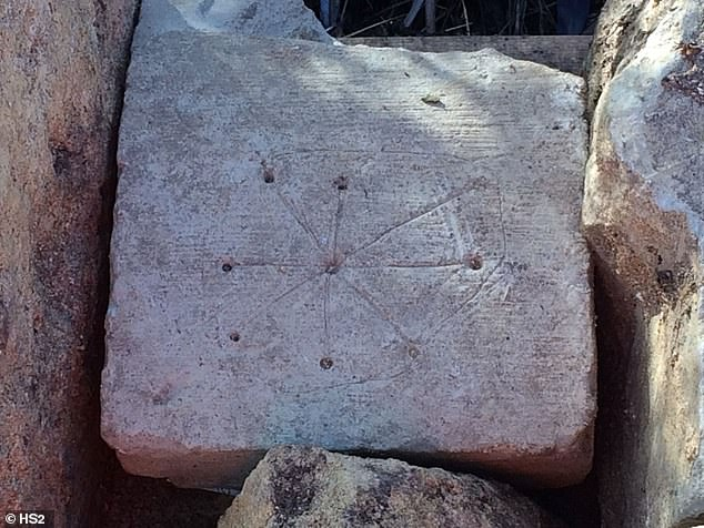 Researchers with HSR, the company involved with the project, spotted engravings on various stones of what was once St. Mary's, which have a central drilled hole with lines etched from it that form a circle