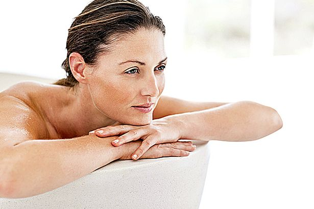 Beautiful mid adult woman relaxing in bathtub