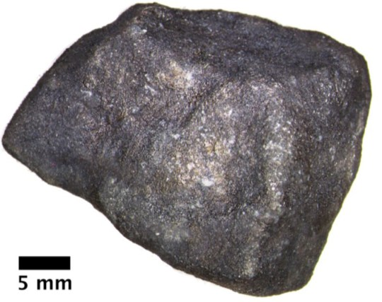 ***EMBARGOED UNTIL 14.00 GMT, TUES OCT 27 (10.00 ET)*** The meteorite fragment that fell on Strawberry Lake which contains pristine extraterrestrial organic compounds. See SWNS story SWNNmeteor; A 'fireball' space rock that smashed into a frozen lake holds the key to the origins of life on Earth, according to new research.The six foot meteor lit up the night sky as it streaked over the US nearly three years ago. It was travelling at about 30,000 mph before breaking up 20 miles above the ground - and crashing into a lake oin Michigan. Scientists used weather radar to locate the pieces which were quickly collected by meteorite hunters - before its chemical makeup got changed by liquid water. Now an analysis published in Meteoritics & Planetary Science has provided a glimpse of what they are like when they are still in outer space.