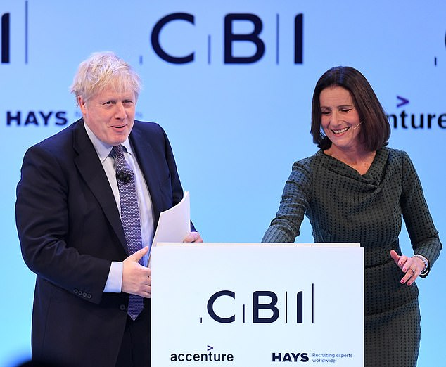 On the same page?: Carolyn Fairbairn with Prime Minister Boris Johnson, who she hopes will adopt her Brexit task force plan to bring Britain's business leaders and ministers together