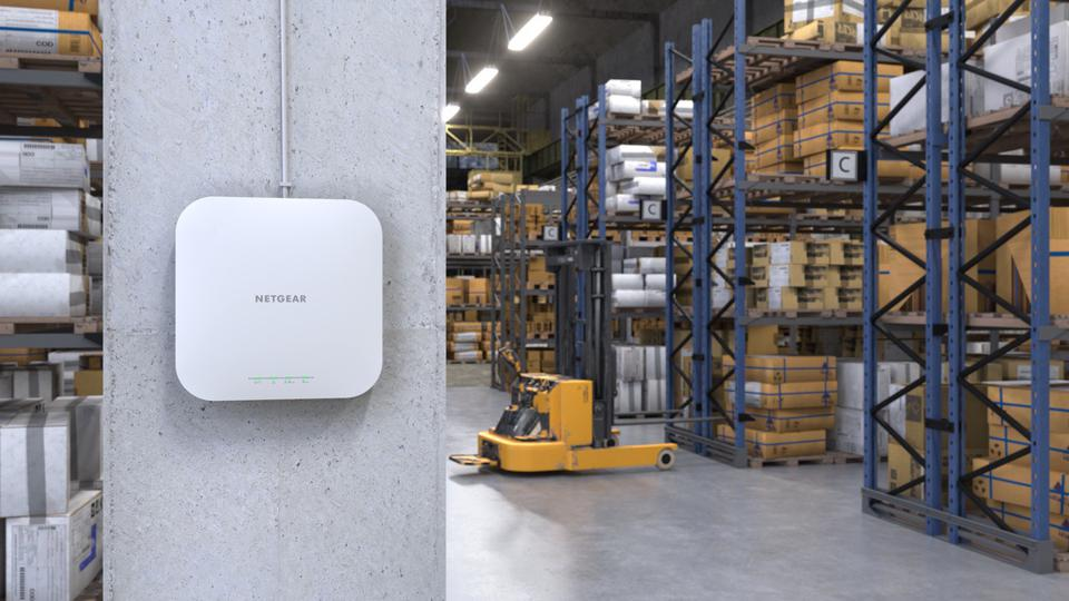 Netgear WAX 610 on a warehouse wall