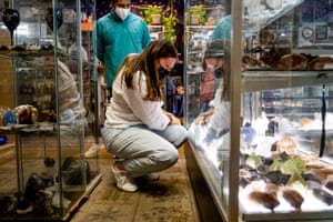 Kyiana Vargas, who's recently become interested in crystals and metaphysical healing because of increased anxiety during the pandemic, looks at different crystals in at Herbs and Arts shop in Denver.