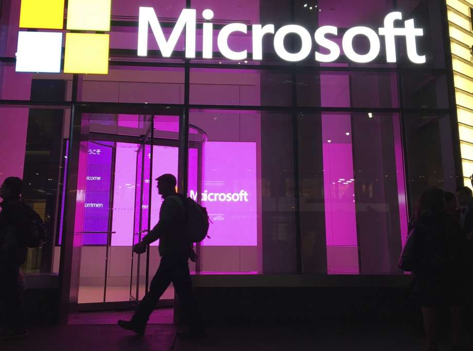 "FILE - In this Nov. 10, 2016, photo, people walk near a Microsoft office in New York.  Microsoft says Iranian hackers have posed as conference organizers in Germany and Saudi Arabia in an attempt to spy on ""high-profile"" people using spoofed email invitations. The tech company said Wednesday, Oct. 28, 2020, it detected attempts by the hacking group it calls Phosphorus to trick former government officials, policy experts and academics. Photo: Swayne B. Hall, AP / Copyright 2020 The Associated Press. All rights reserved."