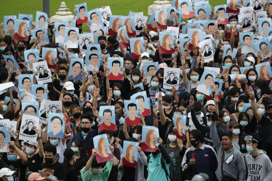 Pro-democracy demonstrators hold posters of protest leaders who have been arrested, during an anti-government protest at Victory Monument in Bangkok, Thailand, Sunday, Oct. 18, 2020. Pro-democracy activists in Thailand launched their fifth straight days of protests on Sunday, scheduling demonstrations not just in the capital but also at several other locations around the country. Photo: Sakchai Lalit, AP / Copyright 2020 The Associated Press. All rights reserved