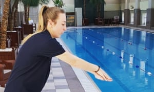 A Turner Swim coach teaching adults