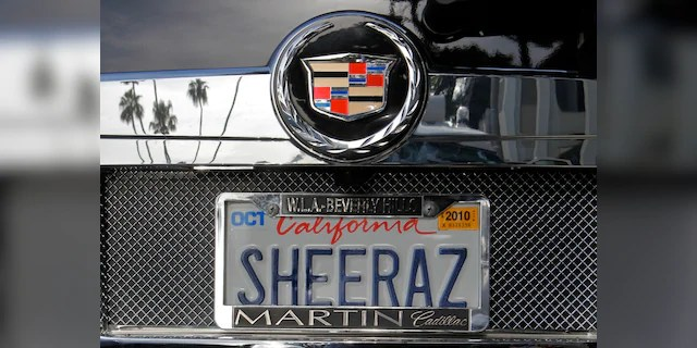 An SUV with a personalized license plate is seen in Beverly Hills, Calif on May 24, 2010. (AP Photo/Damian Dovarganes, File)