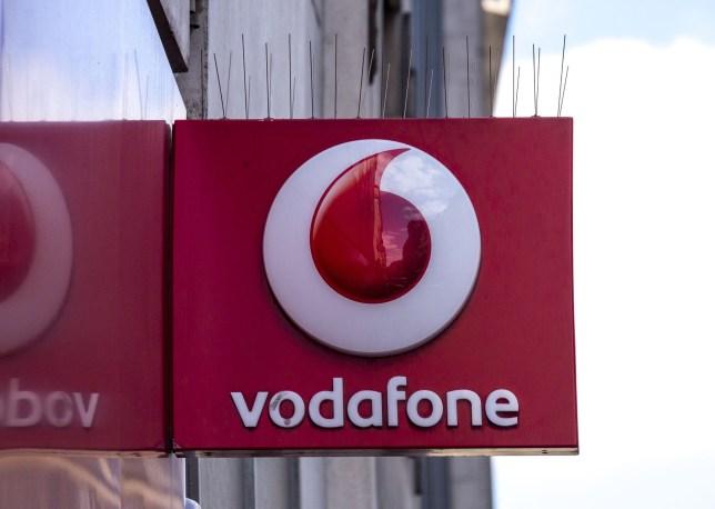 Mandatory Credit: Photo by Steve Meddle/REX/Shutterstock (3217102e) Vodafone Mobile Phone Shop Sign. Various - Jul 2013